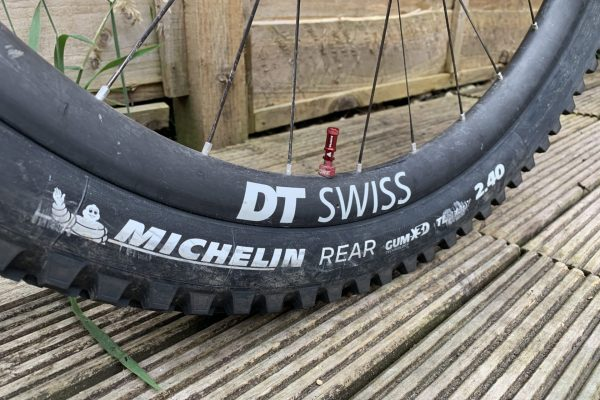 DT Swiss carbon Rims with Cushcore Granite Bikes Juicy Nipple dust cap with Michelin Wild Enduro Tyres